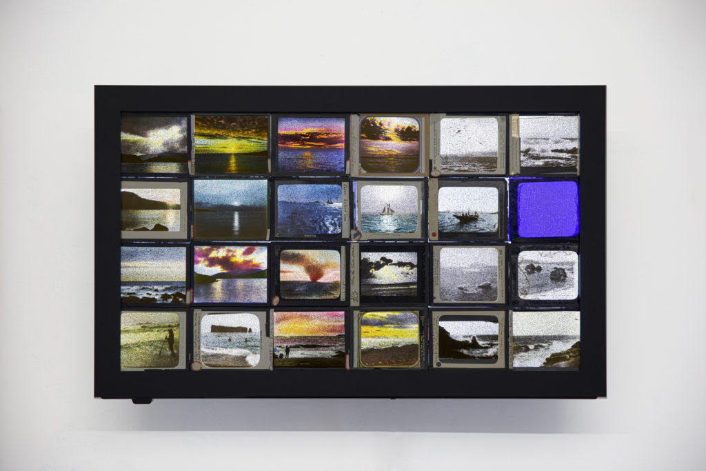 Dana Levy, Twenty Four Seas, 2020, 24 magic lantern slides mounted to a 29'' flat screen TV