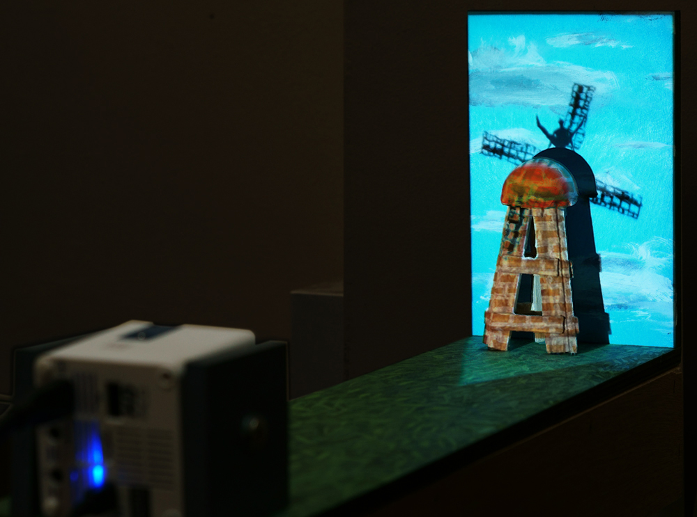 Roy Efrat, Dulcinea, acrylic on plywood, Mini HD projector, foam, single channel video with sound, 50 x 11.8 x 19 cm