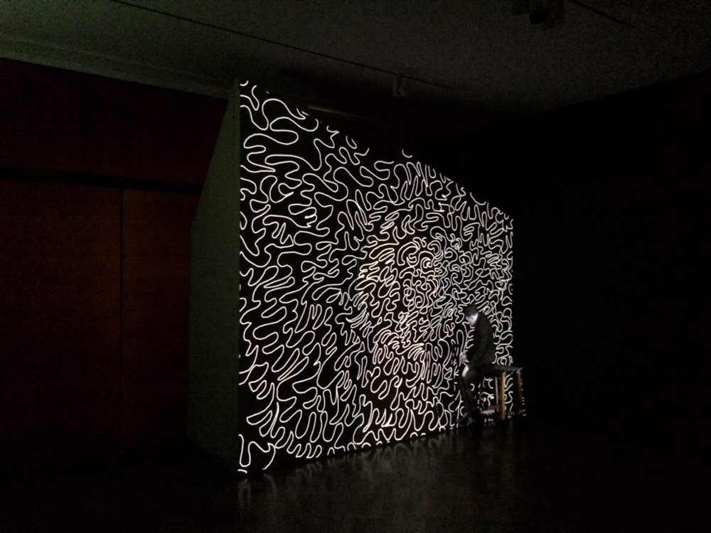 Roy Efrat and Catrin Webster, The Keyhole, 2020, video painting, triptych 488 x 303 cm, single channel projection on oil on canvas, wood, stool and a walking stick, 7:00 min. loop