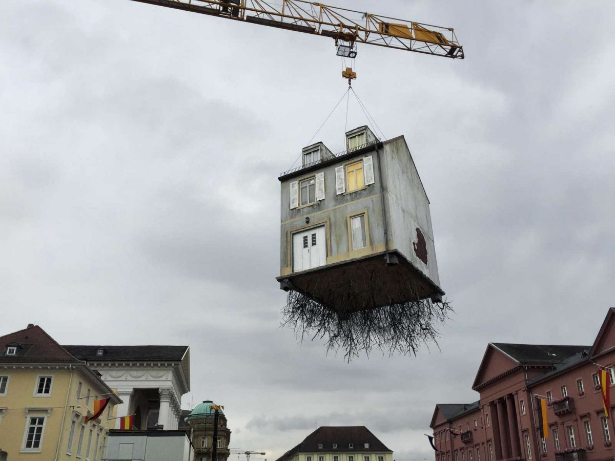Leandro Erlich, Pulled by the Roots, 2015, Installation view, ZKM, Market Place Karlsruhe, Germany