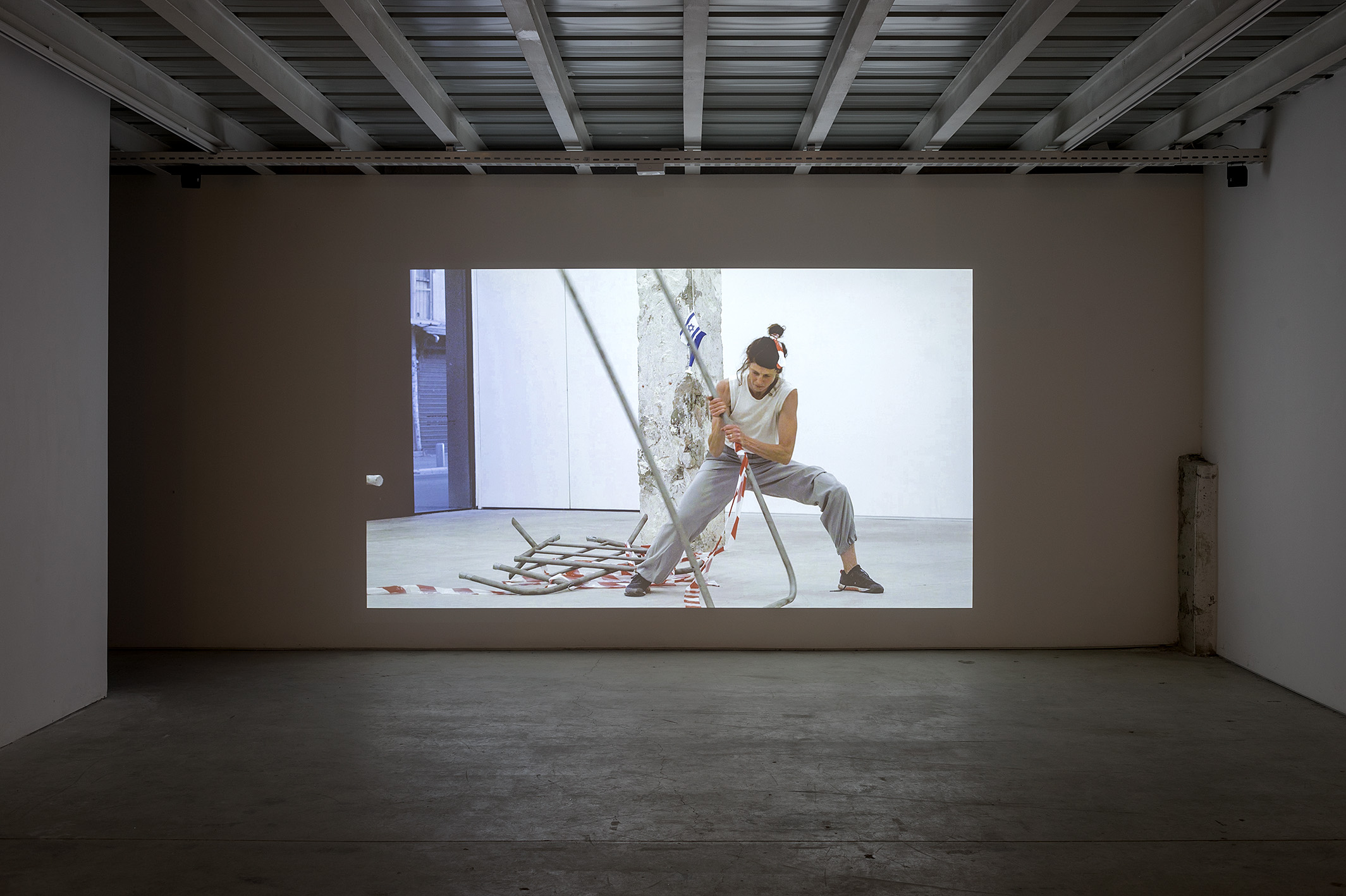 Nira Pereg Guardianess of the Walls, once channel video, Installation view